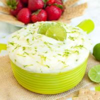 green bowl of key lime pie dip garnished with lime zest