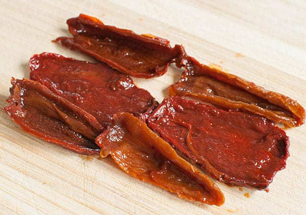 sliced chipotle peppers on cutting board for chipotle dip
