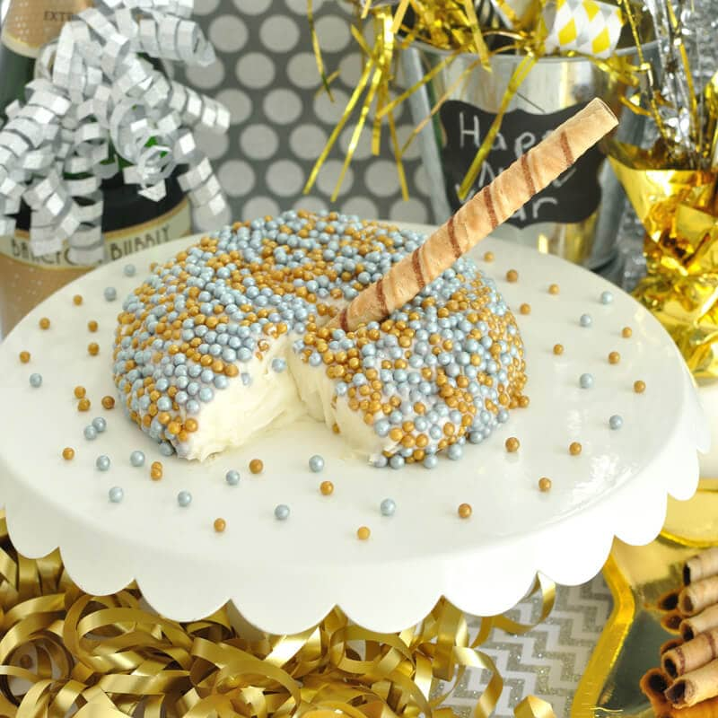 Champagne Cheesecake Cheese Ball- Ring in the new year with this festive and easy dessert dip recipe. Great for your New Year's Eve Party.