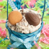 Bowl of Cadbury Creme Egg Dip inside a small blue Easter basket