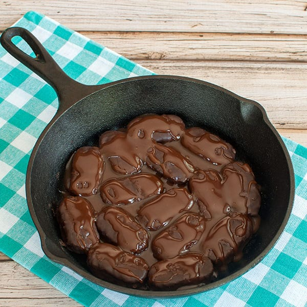 Step 1- Mounds placed in skillet covered with chocolate and caramel sauce