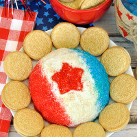 Decorated in a patriotic theme, this Red White & Blue Golden Oreo Cheese Ball is an easy dessert dip recipe for the 4th of July, Memorial Day, or Labor Day.