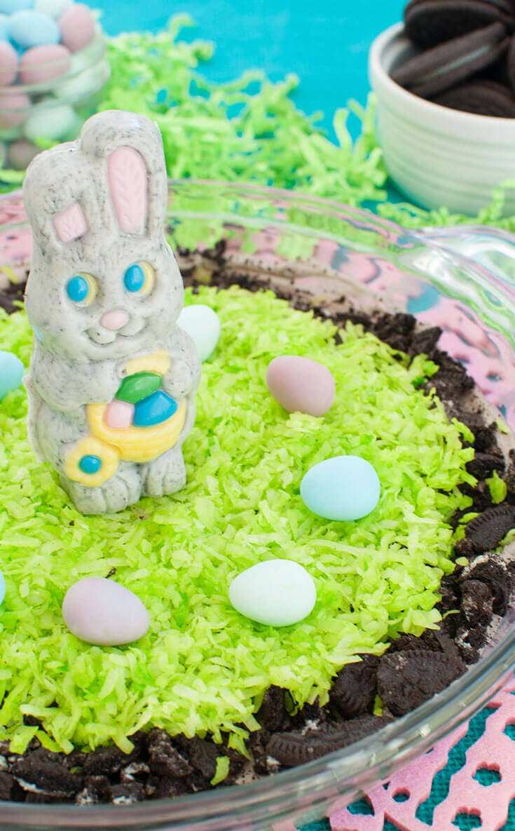 Plate of cookies and cream dessert dip is a cute Easter dessert decorated with a chocolate bunny and mini chocolate eggs