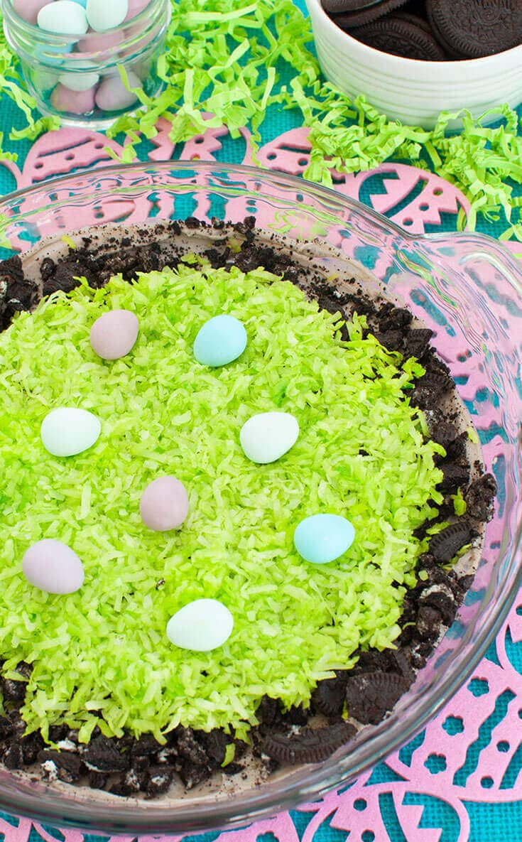 Easter cookies and cream dessert dip in a pie dish with mini Easter eggs on top