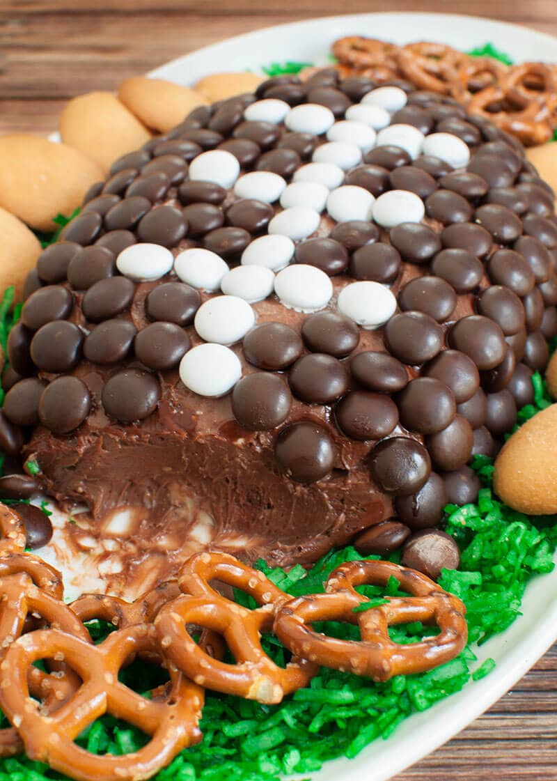 Chocolate dessert cheese ball football with the corner cut into