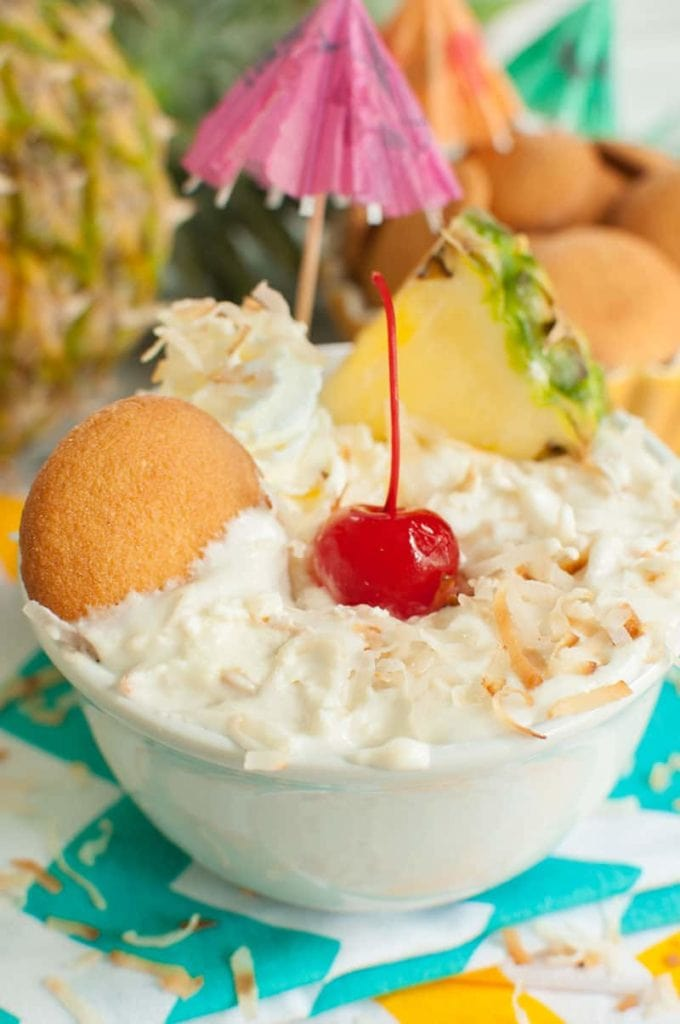 Vanilla wafer dipped into a bowl of Pineapple Dip with Coconut AKA Pina Colada Dip