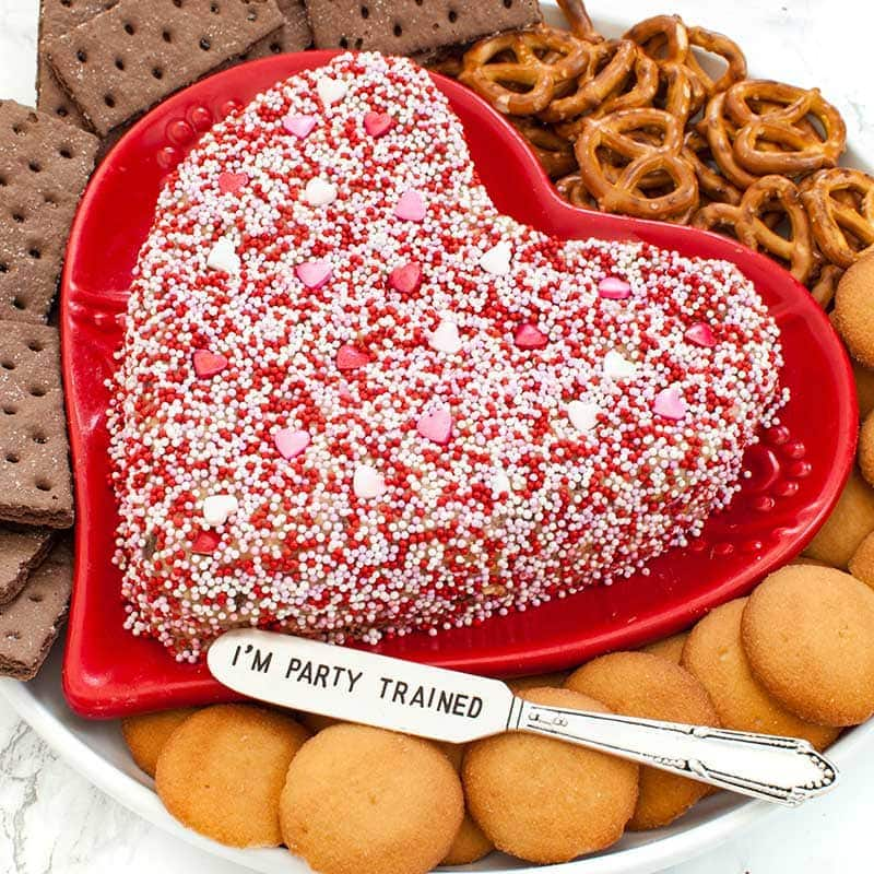 heart dessert peanut butter cheese ball on a red heart shaped platter