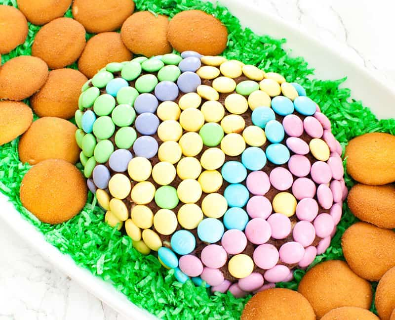 easter cheese ball dessert covered in spring M&Ms with green Easter grass