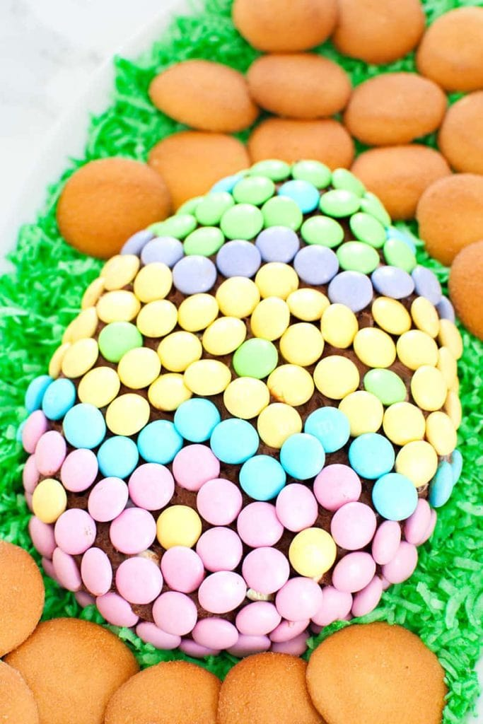 Chocolate Easter cheese ball shaped like an Easter egg covered in spring colored M&Ms