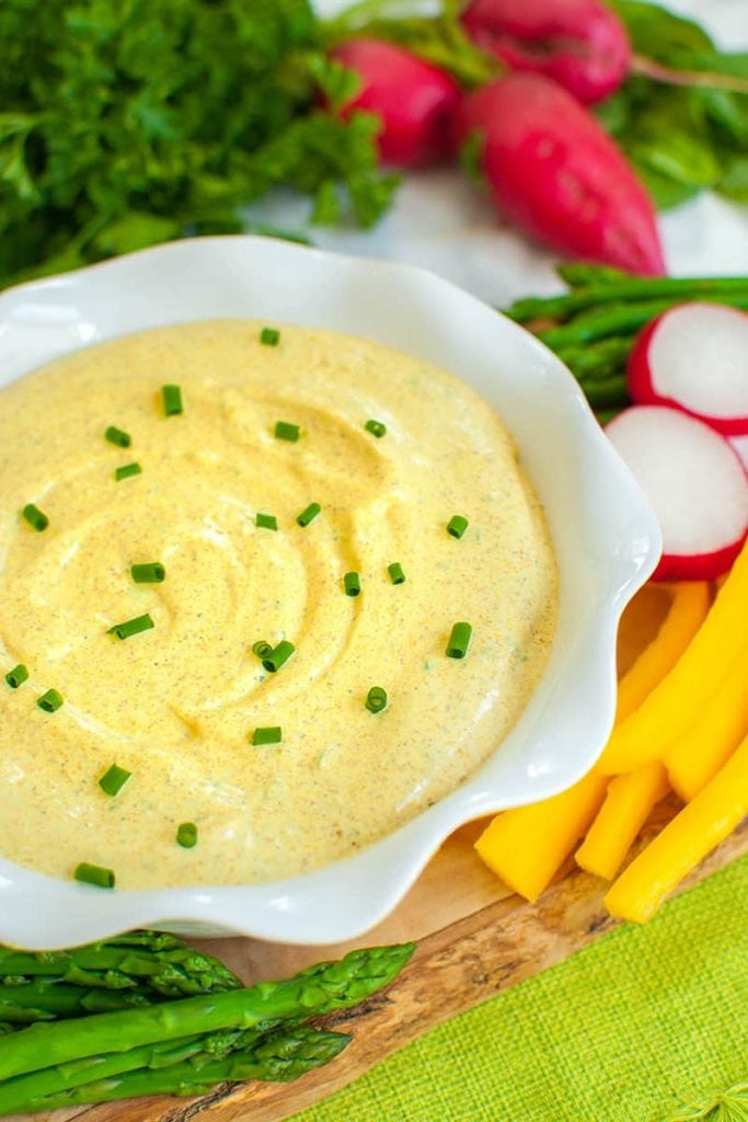 curry dip with asparagus, yellow peppers and radishes